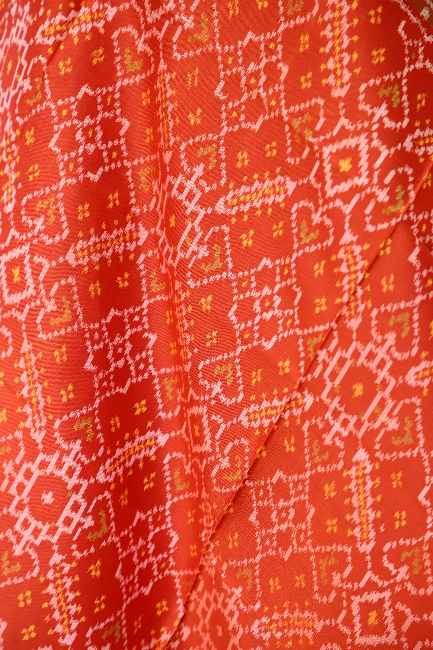 Traditional Navratna Manekchowk mix design in orange and red combination
