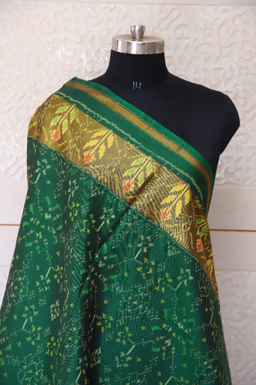 Traditional Navratna design in green colour