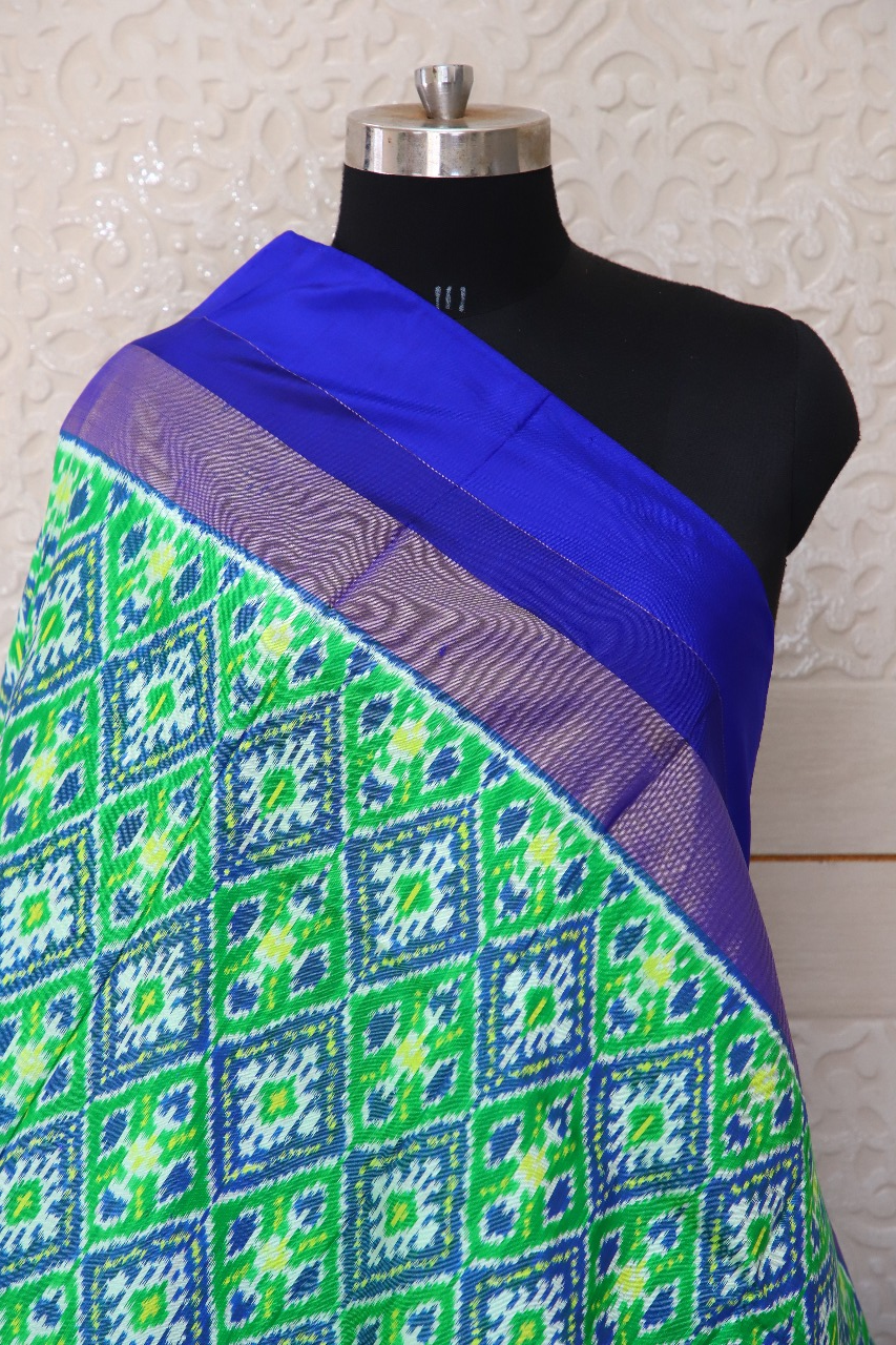 Single ikat dupatta in traditional Paan Chanda design in Parrot Green and Blue colour