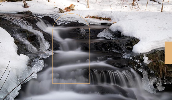 Cascading water down an icy ledge