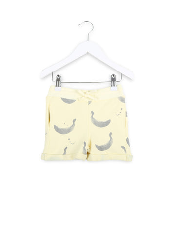 One We Like organic kids shorts with banana print in yellow.