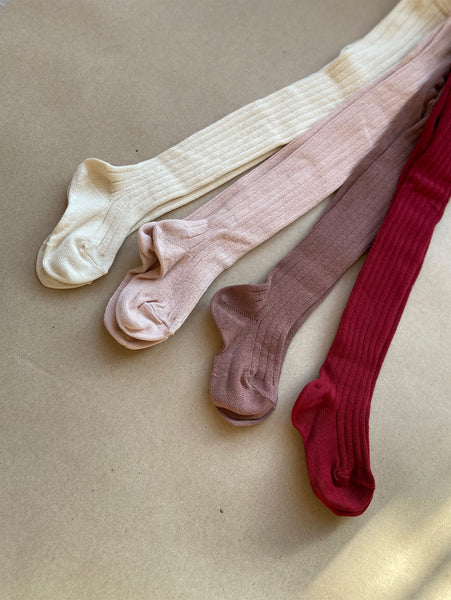 White, pink, dark rose and red tights from Condor
