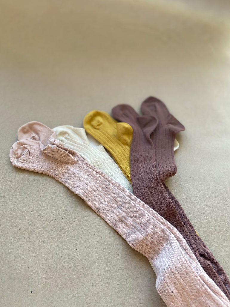 Pink, yellow, dark rose and off white ribbed tights at One We Like