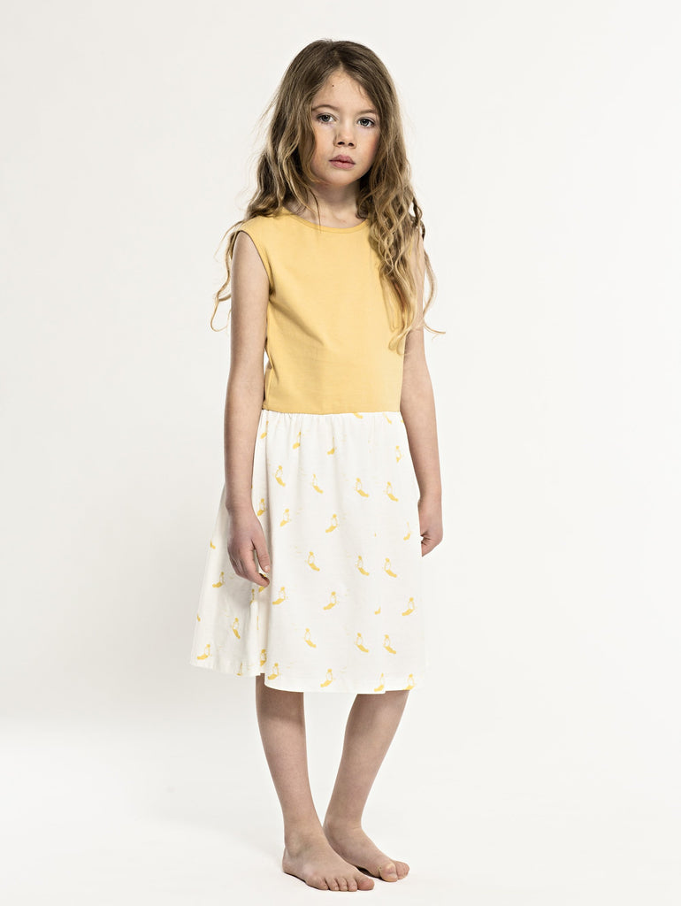 SS19 spring collection from One We Like made of 100% organic cotton. Sleeveless Dress with yellow top and gathered skirt with sunbathing print