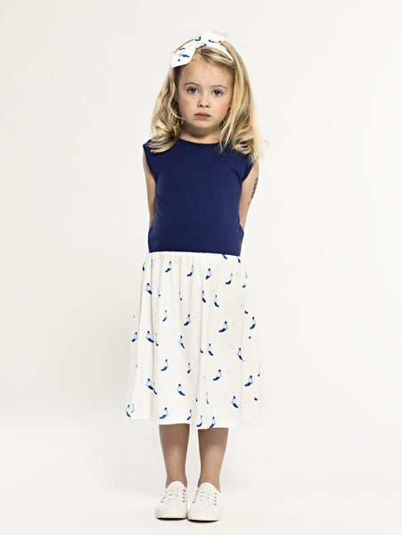 SS19 spring collection from One We Like made of 100% organic cotton. Sleeveless Dress with blue top and gathered skirt with sunbathing print