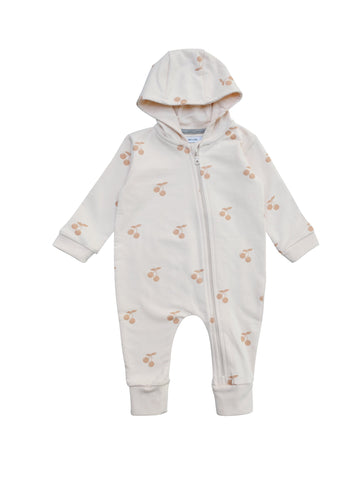All in one baby suit with zipper in front and lined hood. Wear it on it's on as a relaxed sweatshirt suti or with a body underneath as layer two. Cherry print all over on soft pink. Made of 100% organic cotton in Portugal.