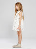 Summery sleeveless dress in white with all over kites print. Frills at shoulder, loose ruched waist and knee length