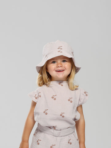 Summer bucket hat in soft muslin fabric. Lilac with darker cherry print. XS and S has strings that can be tied underneath chin.