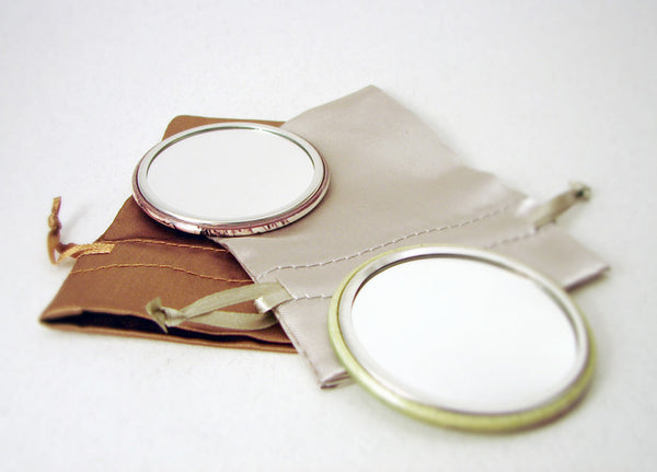 back side of pocket mirror and gift bag