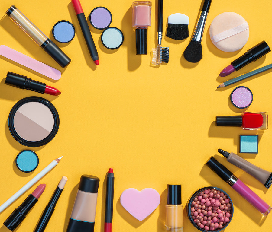 Different beauty products on yellow background