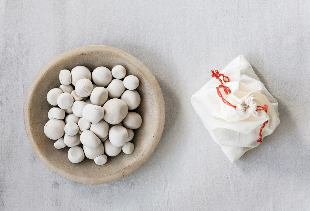 STONE PEBBLES IN COTTON MUSLIN BAG