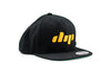 Dip black and yellow flatbill hat profile view