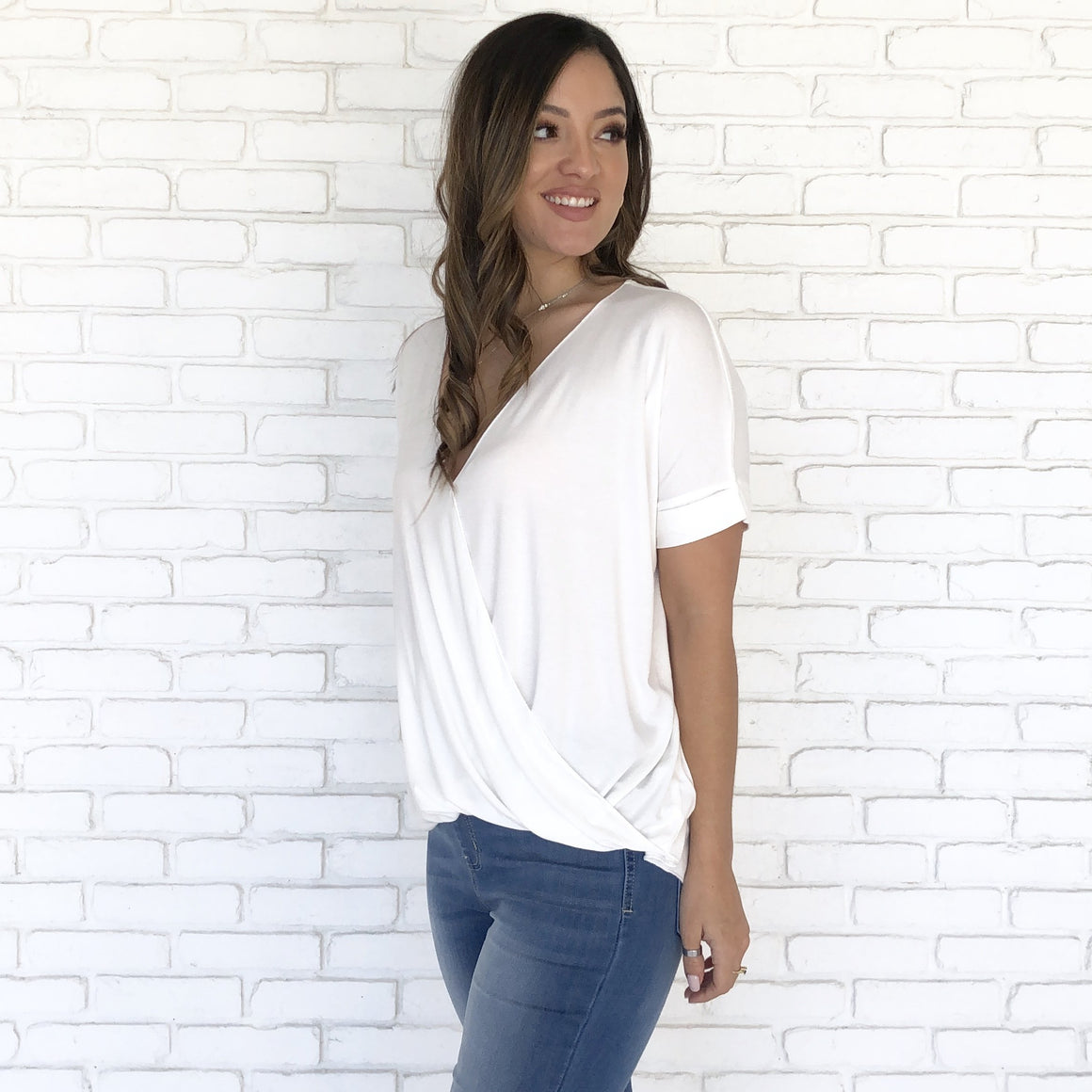 Gerry Jersey Wrap Blouse in White - Dainty Hooligan