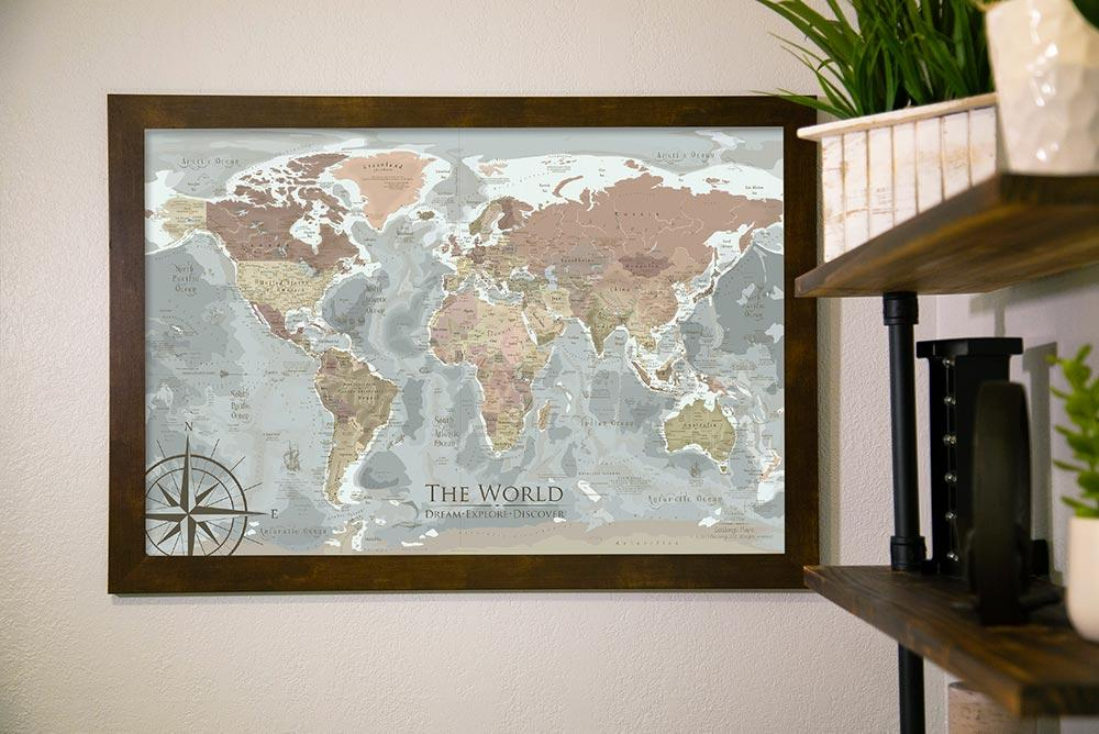 framed world map hanging on wall
