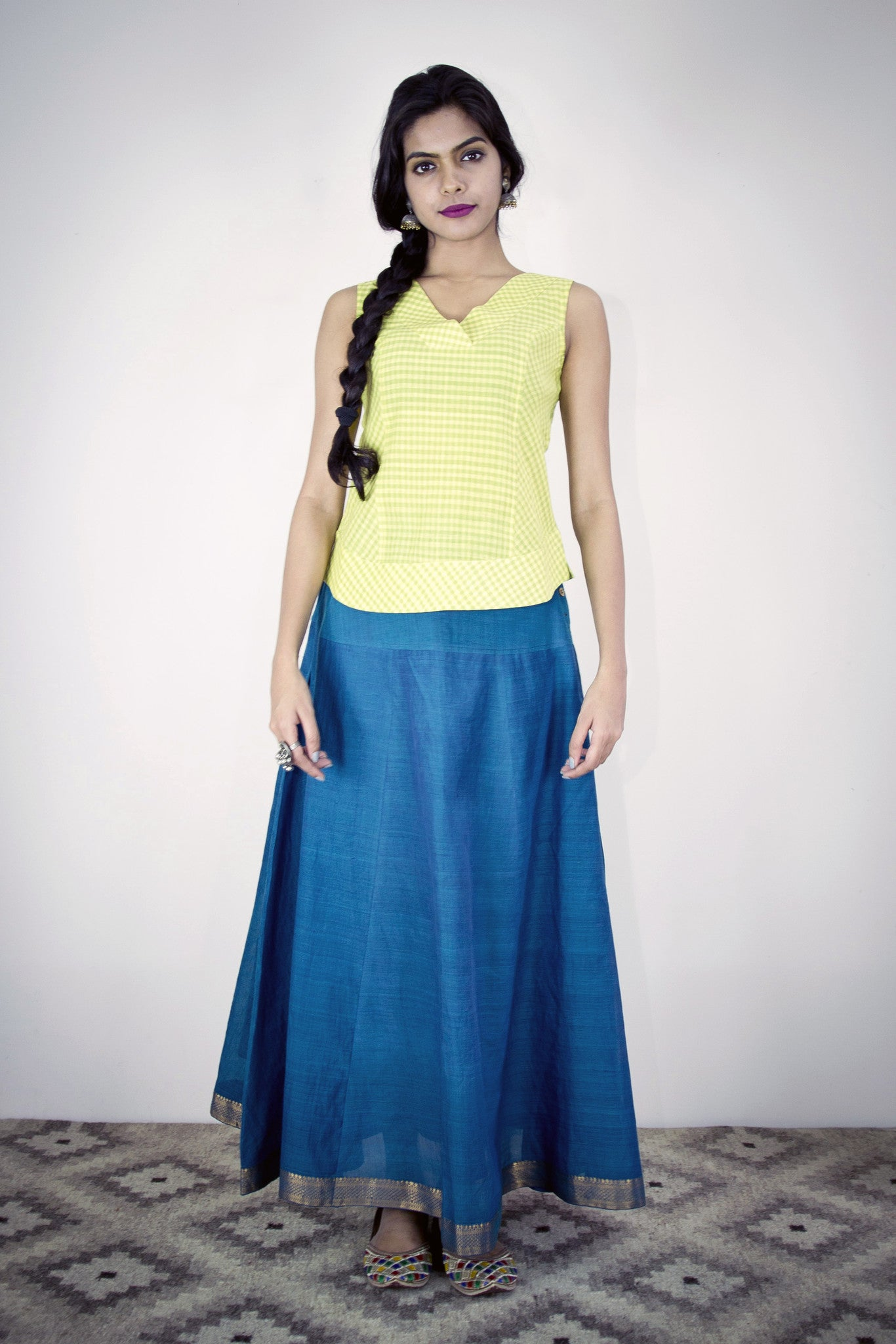 Model is wearing twirl skirt in peacock blue mangalgiri with neon green gypsy top. The skirt has a back waist elastic. With lining.