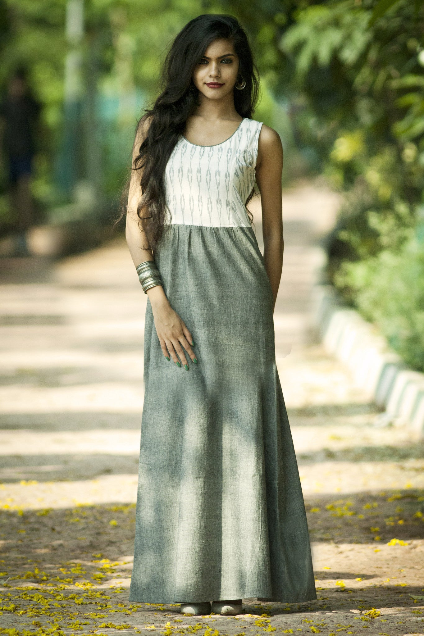 Model is wearing the summer dream maxi in white black ikat with grey cotton.