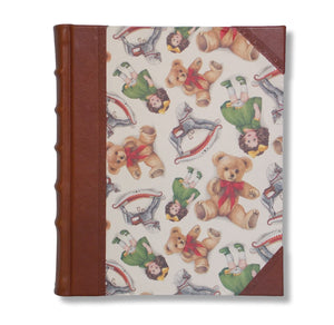 Photo album with brown leather spine and teddies and dolls printed sides