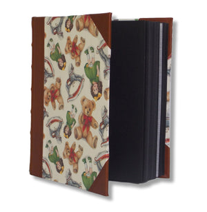 Teddies and dolls portrait leather album has black dry mount pages with interleaving tissue