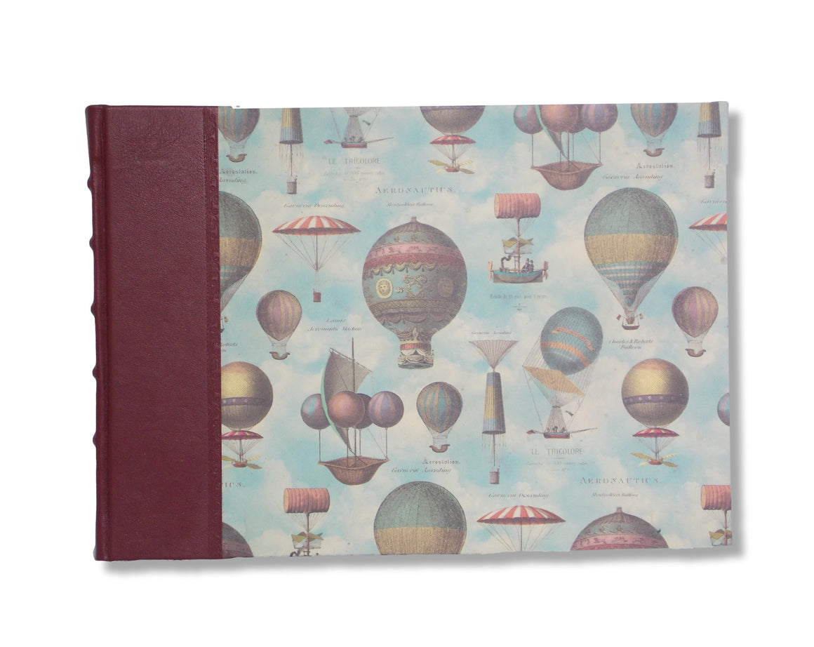 Landscape sized quarter leather photo album.  Hot-air balloon design.