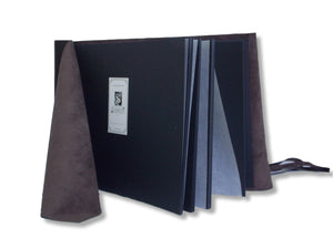 black pages inside leather wrap photo album