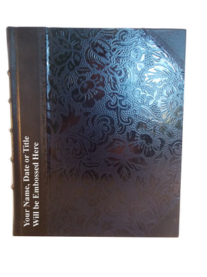 Black leather album showing position of personalisation