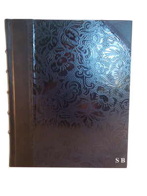 Black leather album showing position of initials embossing
