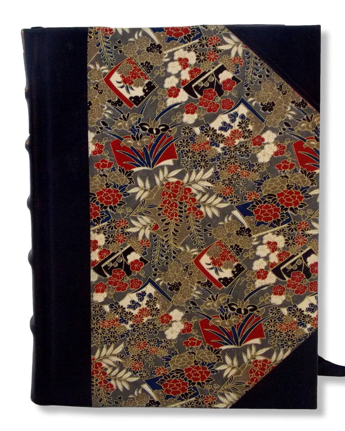 Black leather half journal featuring Japanese washi printed sides