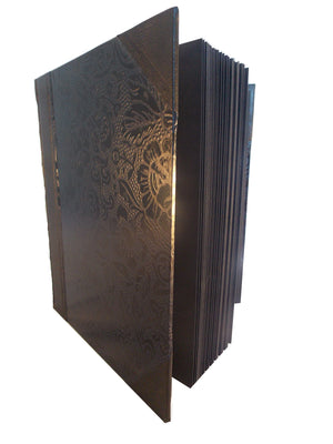 Side view of black leather photo album with Japanese washi sides