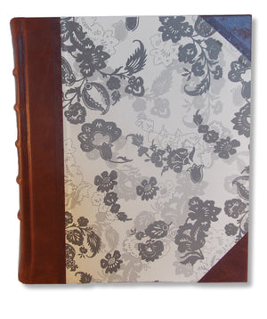 Portrait album with brown leather spine and Italian paper sides