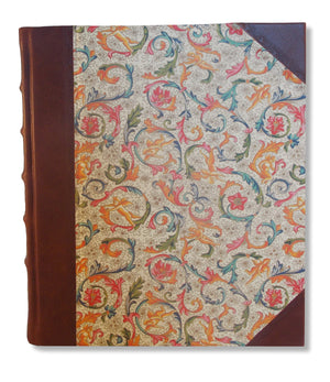 Half leather photo album with traditional Florentine design paper sides.