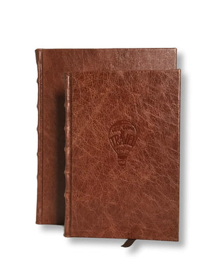 Leather travel journal shown in 2 sizes