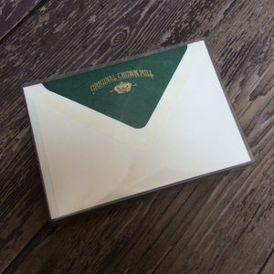 Correspondence cards with dark green lined envelopes