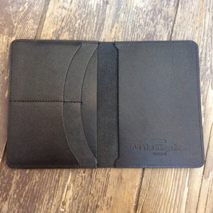 Inside pockets of black leather passport wallet