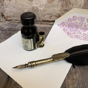 Feather dip pen with ink