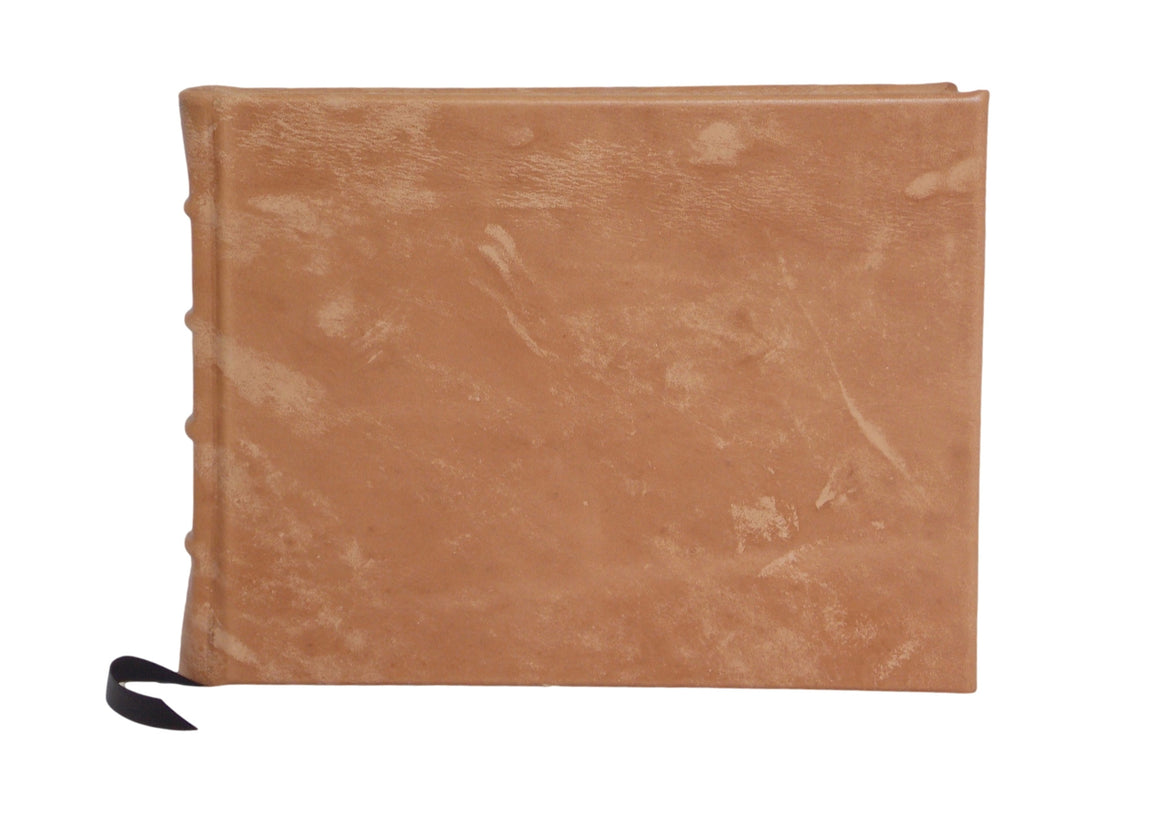 Full leather guest book in light brown with printed end papers