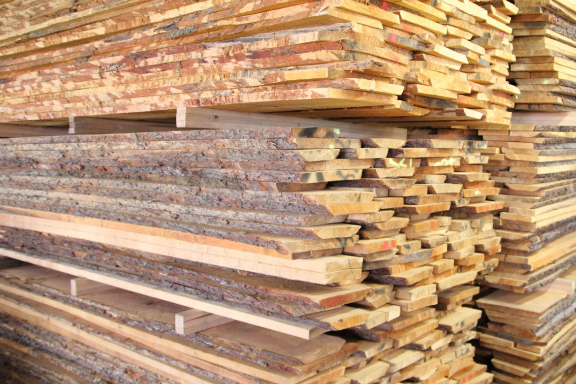 furniture construction raw wood planks stacked FSC certified