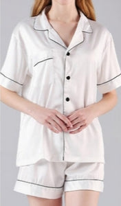 white satin short pyjama set with black trim and black buttons