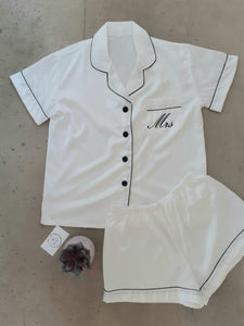 Personalised white satin pyjama set with black trim and black buttons