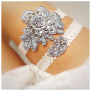 bridal garter set with dusty blue embroidered flower and silver sequin embellishment