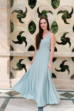 Load image into Gallery viewer, Model wearing a Smooches Bridal infinity dress in a sage green colour.  Edit alt text