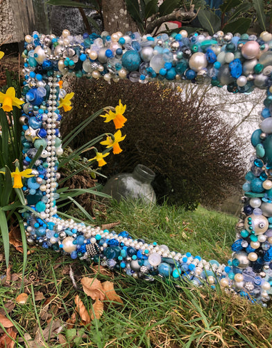 Sea of Blues Treasure Mirror made from hundreds of beads, baubles and trinkets in turquoise, blues, silver and pearls, hand made by Tara Cole Mirrors