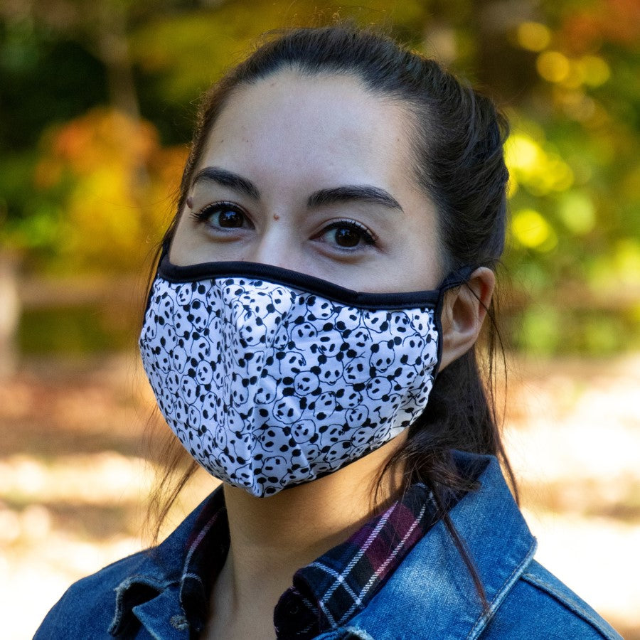 Panda print face mask modelled by an adult female