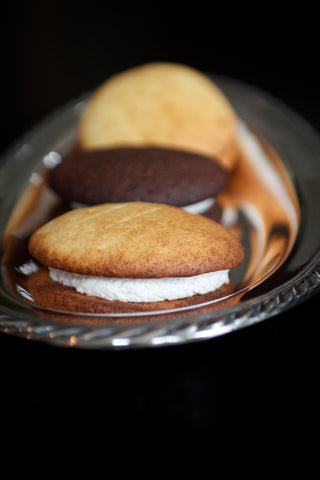 three whoopie pies on a small silver platter