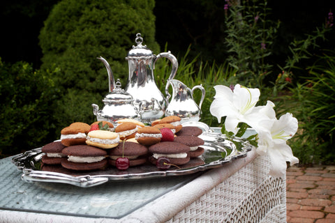 whoopie pies and tea kettle on a silver platter