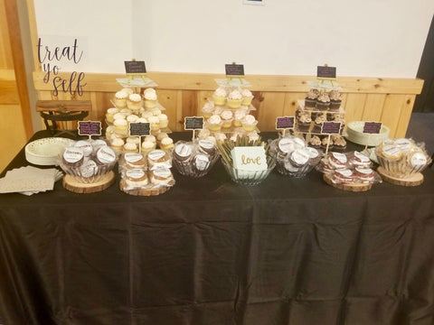 wedding dessert table with whoopie pies and cupcakes