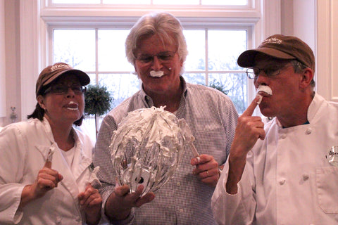 three friends in chef's coats eating whoopie pie filling