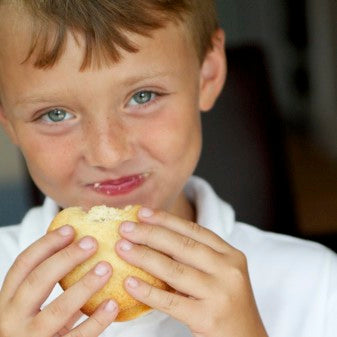 little boy eating a whoopie pie