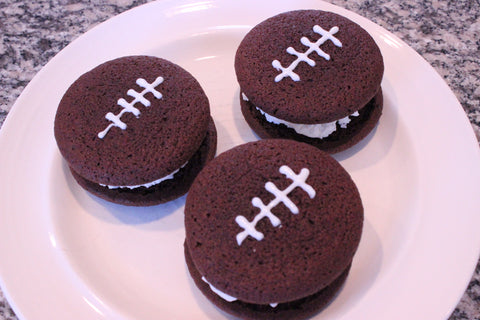 whoopie pies decorated like footballs