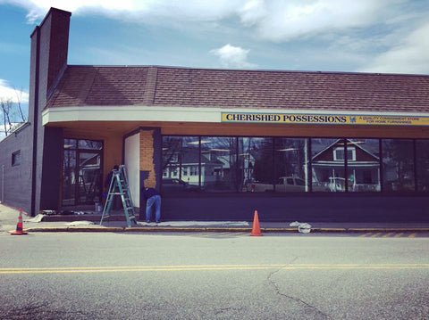 whoopie pie bakery and coffee shop storefront being painted