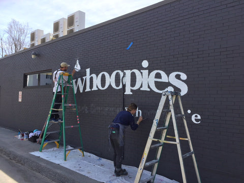 painters painting cape whoopies bakery sign